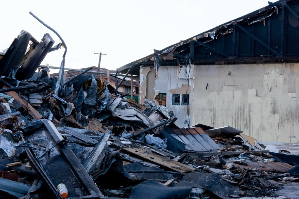 Destroyed building remains from a fire blaze
