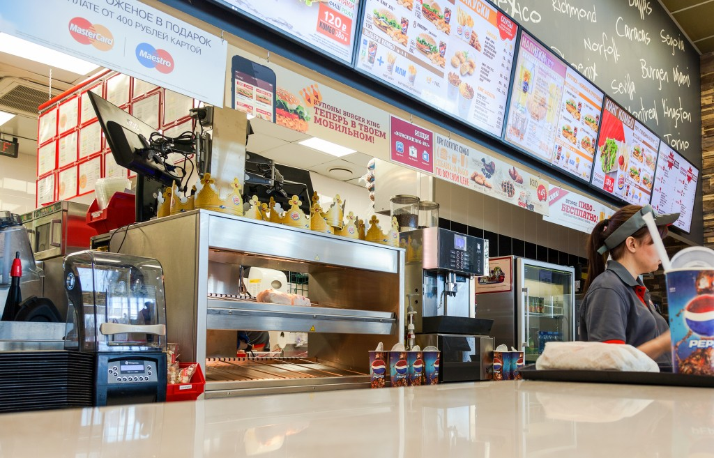 SAMARA RUSSIA - AUGUST 30 2014: Burger King fast food restaurant in hypermarket Ambar. It is the second largest fast food hamburger chain in the world
