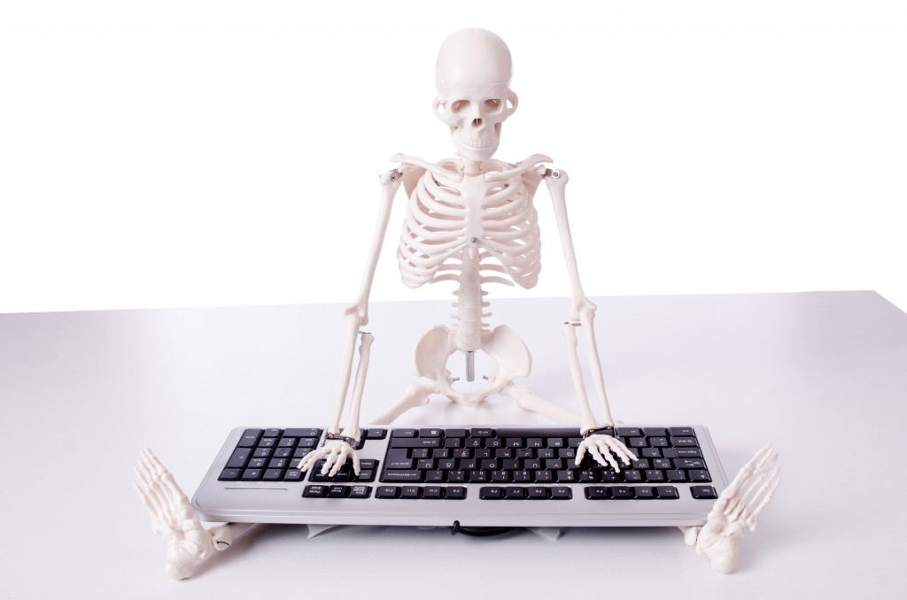 Funny Skeleton working on computer