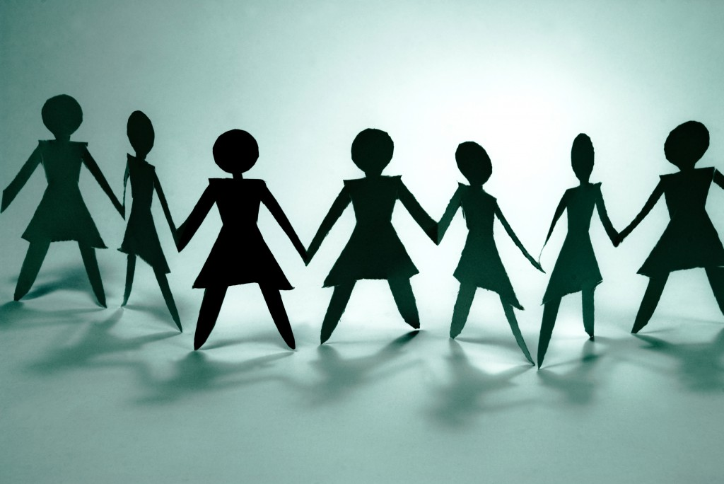 shadow figures of women in group join