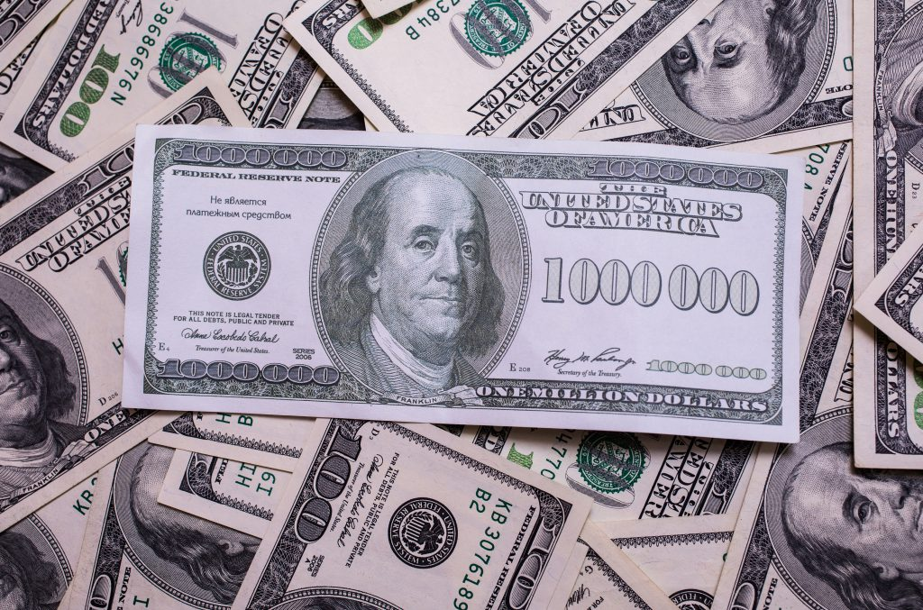 bill of one million dollars a new brilliant idea a million dollars the thirst for wealth success get rich millionaire background of the moneybackground of dollars old hundred-dollar bill face Benjamin Franklin